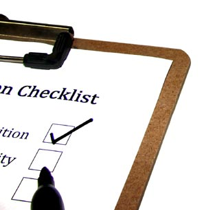 A checklist for tool inspection with a marker pointing at a checkbox