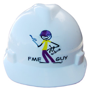 The front of a white hard hat has a sticker with a cartoon man on it