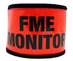 An orange arm-band with FME Monitor printed in black letters