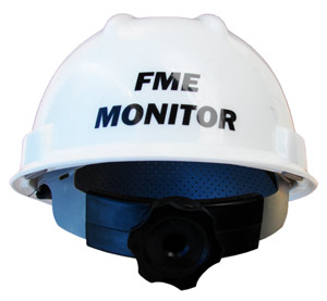 The back of a white hard hat with a sticker reading FME Monitor