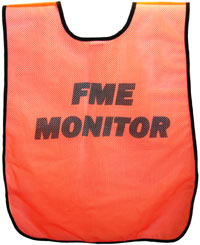 The back of an orange vest printed with the text FME Monitor