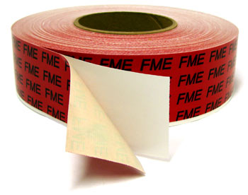 A closeup of a roll of printed FME duct tape showing the paper backing