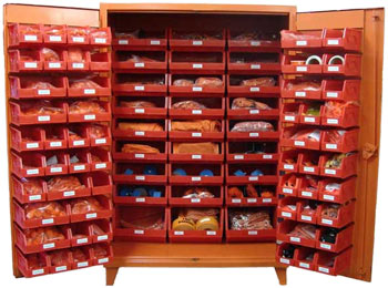 A Large Orange Cabinet Stocked With A Large Variety Of Foreign Material  Exclusion Supplies
