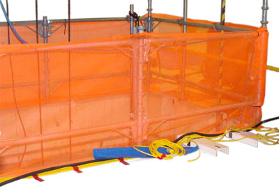 An orange net surrounds a cavity that is under foreign material exclusion controls