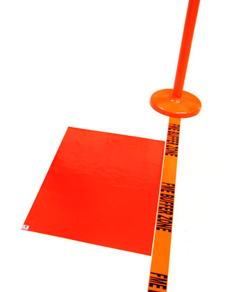 A sticky mat is located next to a strip of floor tape reading FME Buffer Zone