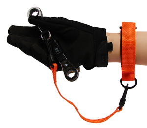 An orange wrist strap attached to a tool to prevent dropping