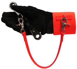 An orange wrist cuff with velcro closure is attached to a tool with a tether