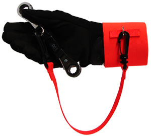 A plastic ended tether is used to attach the wrist cuff to a tool being held by a gloved hand